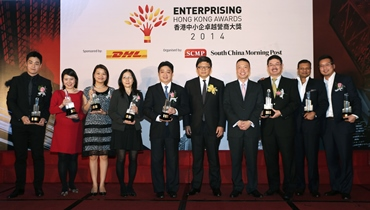 (From L) Winners Jonathan UNG of Drop-Shipping Global Services Ltd, Rendy Ng of Bee's Diamonds, Anita Lee, 4M Industrial Development Ltd, Fanny Fan of Ultra Active Technology Ltd, Stanley Wong of Chuan Chiong Co.Ltd, Robin Hu, CEO of SCMP Group, Ken Lee, Executive Vice President, Commercial, Asia Pacific, Managing Director, Hong Kong and Macau of DHL Express, Herman Lo, Fu Hong Industries Ltd, Girish Jhunjhnuwala of Ovolo Hotel and Alan Lim of E-Services Group Ltd, pose during the Enterprising Hong Kong Awards at Admiralty.  25SEP14